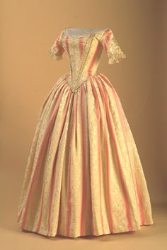 Maggie May Fashions- Clothing History Research Pages. Silk brocade, c.1840. Very pretty :)  http://www.maggiemayfashions.com/romantic.html#