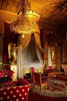 Extravagant gold and red bedroom at The Château de Malmaison, a country house about 7 miles from Paris. It was formerly the residence of  Josephine de Beauharnais & her husband General Napoleon Bonaparte, and with the Tuileries, was from 1800 to 1802 the headquarters of the French government.