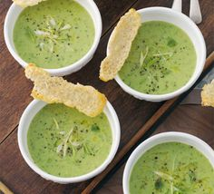 Pea, mint & spring onion soup with Parmesan biscuits. The Parmesan 'tuiles' make this soup stylish enough for entertaining - but they take just a few minutes to make! Bbc Good Food Recipes, Soup Recipes, Cooking Recipes, Healthy Recipes, Recipes Dinner, Healthy Food, Spring Onion Soup, Pea And Mint Soup, Onion Vegetable