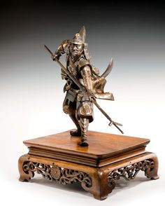 JAPANESE BRONZE SAMURAI HOLDING A YARI Just Japanese antiques are based in Chichester, England.