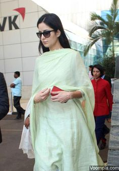 So pretty! Natural beauty Katrina Kaif spotted in a light green salwar kameez and without any makeup. via Voompla.com