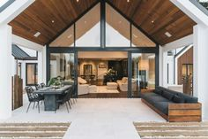 The deep outdoor spaces on this home mitigate ceiling estate house interior design living room lobby real estate window brown white Modern Barn, Post Modern, House Extensions, House Goals, Home Fashion, Design Case, Outdoor Spaces, Outdoor Dining, Outdoor Sofa