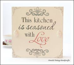 Sign Message: ~❤This kitchen is seasoned with Love❤~ This wooden sign is a accessory for the kitchen. My handmade wooden signs make the perfect present for your friends, family and loved ones.  • Sign Details & Materials: Wood pallet is painted Annie Sloan chalk Old White. The piece.sign that measures: 20 x 20 x 3,8 cm Printed wording is black and red Each sign is distressed & finished by hand for a unique look you'll find nowhere else.