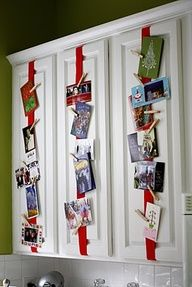 Attach ribbon to kitchen cabinets + use clothespins to hang cards. Perfect idea for the clothes pins