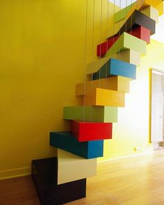 WEBSTA @ designboom - connecting the lower and upper floors of a narrow, duplex apartment in paris is this vibrant 'pop #staircase' by architects laila nady and thomas huchet.see more #architecture and #interiors on #designboom