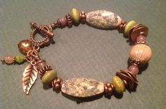 My Art bead this month is an enameled bead  by C-Koop... paired with lampwork, ceramic, Czech, semi precious, and copper beads. http://terrisbloomingideas.blogspot.com/2014/11/abs-november-challenge.html