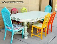 I love brightly colored, mismatched, vintage chairs together around a wonderful vintage table!!!