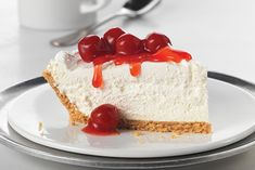 Whipped topping gives this cherry-topped no-bake cheesecake its amazing height. Fluffy? Yes. But it's sure to dominate the dessert table.