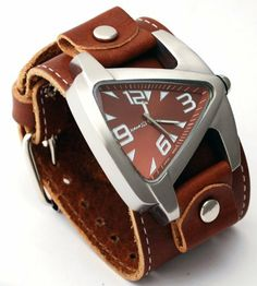 Nemesis #BLBB011B Men's Signature Collection Wide Leather Cuff Band Brown Dial Teardrop Watch Nemesis. $72.97. Precise Japan Quartz Movement. Stainless Steel Case with Genuine Wide Leather Strap. Mineral Crystal, Luminous Hands and Markers. Case Size: 50mm Diameter, 10mm Thickness. Water Resistant - 30M