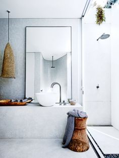 Large mirror with bowl sink.