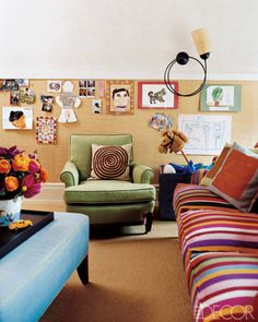 A bulletin board covered in Hinson & Co.'s Madagascar raffia and a sconce by Antkoviak in the playroom of Eve Robinson and Joshua Wiener's Upper West Side apartment; the sofa is upholstered in Donghia's Hamaca Rojo cotton.