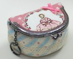 Metal Frame Coin Purse Tutorial - not typical style!  This one is very cute!