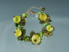 Handmade Glass Gooseberry Bracelet with lifelike glass gooseberries. Unforgetable gift for favorite foodie, gourmet cook or gardener. $350. By Elizabeth Johnson.