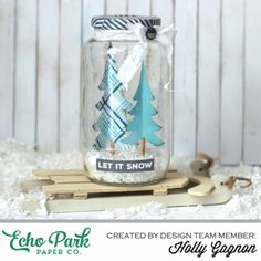 "Up-Cycle an old jar into a lovely wintery snow scene using the ""Hello Winter"" collection by #EchoParkPaper.  Designer Holly Gagnon created this project and share a step-by-step photo tutorial on the Echo Park Blog.  She incorporated Silhouette cut files, along with washi tape, and more!"