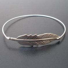 Hey, I found this really awesome Etsy listing at https://www.etsy.com/listing/81203287/boho-jewelry-feather-bracelet-hippie