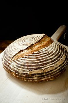 Rustic Bread  For the poolish preferment:  55g bread flour 55 room temperature water small pinch (less than a gram) instant dry yeast  For the final dough:  819g bread flour 510g warm water 18 g salt 3g instant dry yeast