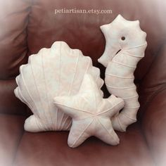 THIS IS A SET OF THREE PILLOWS IN DIFFERENT SHAPES - Seahorse, Seashell,and Starfish. These elegant nautical pillows are handmade from soft polyester fabric with floral pattern in peach and filled with non-allergenic fiberfill. They are a lovely decor for a living room, play room, nursery, beach houses, etc. They can be mixed and matched with my other sea-creature shaped pillows. Please add a note to your order if you want some of the pillows in different colors. Sizes: Seahorse - 19 x 7…