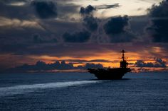 PACIFIC OCEAN (Sept. 8, 2012) The aircraft carrier USS George Washington (CVN 73) is underway near Guam at sunset. George Washington is the centerpiece of Carrier Strike Group (CSG) 5 based out of Yokosuka, Japan, and is currently on patrol in the western Pacific. (U.S. Navy photo by Mass Communication Specialist 3rd Class Paul Kelly/Released)
