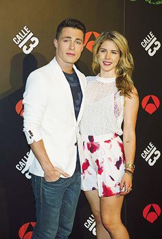 """Emily Bett Rickards and Colton Haynes attend the """"Calle 13"""" photocall at the Villamagna Hotel on June 9, 2014 in Madrid, Spain."""