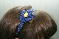 Blue and White Polka Dot Nautical Elastic Headband with Matching Flower and Yellow Embellishment.