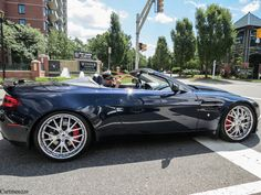 Photo of Chris Tucker Aston martin - car
