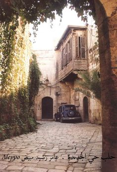 Aleppo alley with old Citroen French car