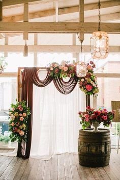 If we add burgundy, blush, or gray draping to the arch and a corner sway of flowers we can meld the too styles.