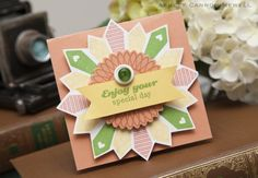"""flower shape created with a """"tie"""" stamp which was stamped in a circular pattern with the knots in the center that get covered by the focal embellishment!"""