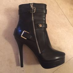 Guess Leather Black Buckle Boots Guess heeled leather boots with silver buckle and leather straps. Some damage to the right toe and some indents on the platform shown in the forth picture. Size 8.5 UNIF Shoes Heeled Boots