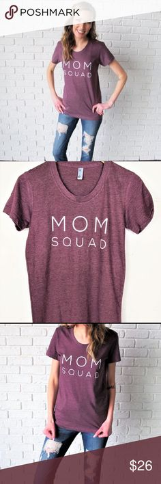 """Mom Squad Mom Tee I bought this super cute mama graphic t-shirt as a gift for someone for Xmas but it runs small so it won't fit. It says Large but runs more like a medium. Please follow measurements. Awesome heather plum color. ▪️Size Large (runs small!) ▪️17.5"""" across bust, 26.5"""" shoulder to hem. ▪️50/50 poly cotton. New with tags! American Apparel Tops Tees - Short Sleeve"""