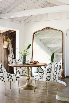 Tulipa Dining Table brass base, wooden top with brass accents Anthropologie #'diningroomchairs'