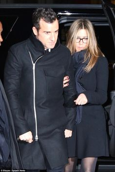 Wrapping up: A frozen-looking Jennifer clung onto Justin as they headed out in NYC...