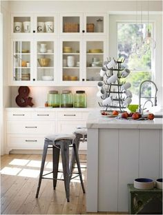 I could see us here in the mornings. gray island white surround cabinets - bhg