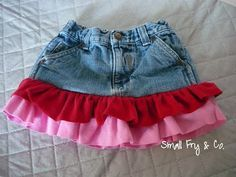 Some guidance for turning AJ's favorite (but ripped and too short) jeans into a skirt... I'm thinking longer tiers, though. [UPDATE: Did it! Used an old t-shirt to make the second tier longer. Super-easy and cute!]