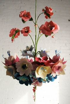 paper flowers. make a dull apt. feel more alive with colorful flowers that last all year.