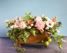 Our Blonde Wood Trough adds a rustic touch to this mix of ranunculus and greenery.