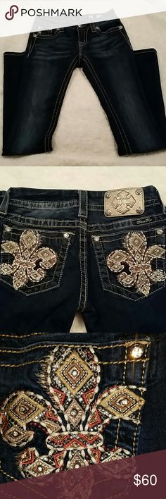 "Miss me jeans 🎈🎈 SALE 🎈 🎈 Beautiful, blingy Miss Me jeans with embroidered, rhinestone - encrusted fleur-de-lis pockets in Euc. Like new, no missing rhinestones.  Dark wash.  Inseam 33"". Style#JE8291SBL. Signature slim boot. Only SLIGHT signs of wear on hem. Gorgeous jeans. Miss Me Jeans"