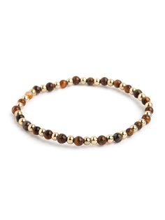 This striking style taps into the crafty allure of the traditional wood mala bracelet, but those extra gold beads gives the look its glitz factor. The best of both words, we say.