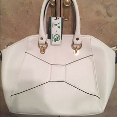 """Women's Isabelle Ivory Handbag New Great Deal.. Women's Isabelle Ivory Handbag New, with beautiful inside fabric as shown on photo. Also comes with strap. size approx. 15x15 and about 17"""" high with handles, great everyday purse.Great Deal. Retail $ 89 GET IT TODAY FOR $65 Please visit my closet for other great deals..SHARE, SHARE, SHARE. Will return the favor on each SHARE.. OFFERS ACCEPTED. Bags Shoulder Bags"""