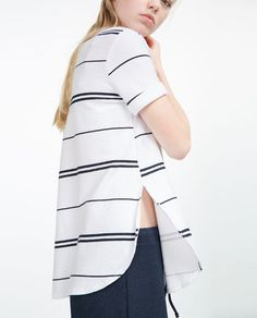 Image 1 of CHECKED T-SHIRT WITH SIDE SLITS from Zara