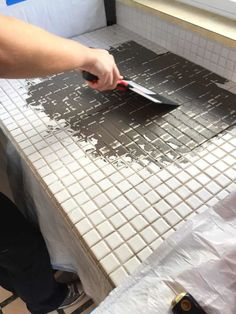 Kitchen Countertops Remodeling Spreading feather finish concrete over tile counters - Bye tile counters, hello industrial concrete! Read the full rundown of how to apply feather finish concrete over tile counters.