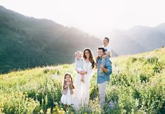 Cool blue and white color palette family photoshoot utah wild flowers family outfit ideas