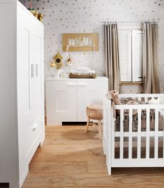 Love the crib in the middle of the room. Great layout! Nursery via kidsfactory