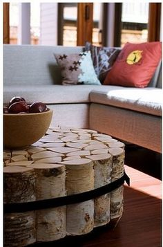 coffee table made from logs strapped together.