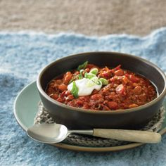 Smoky Beef-and-Bacon Chili    Like most chilis, this one is even better when made ahead. You can even freeze it up to a month or so beforehand and take it along in a cooler. We love the smoky bacon in this chili.