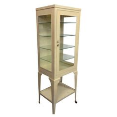 Antique Metal & Glass Apothecary Cabinet  on Chairish.com
