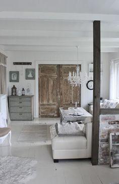 chandelier in bedroom, rustic closet doors    |   Mias Interiør