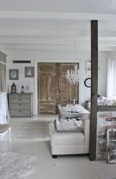 chandelier in bedroom, rustic closet doors    |   Mias Interiør