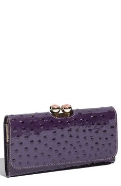 Ostrich embossed clutch wallet, $145. I don't wear animal fur or skin, but this is pretty!