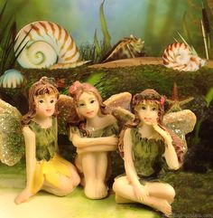 Miniature Fairy Figurines in the mini fairy garden.